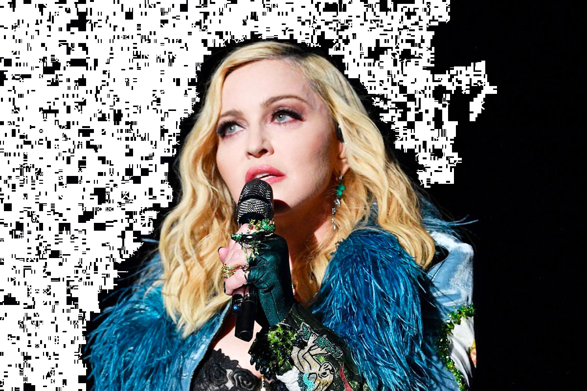 Madonna poses in topless with crutch after getting injured