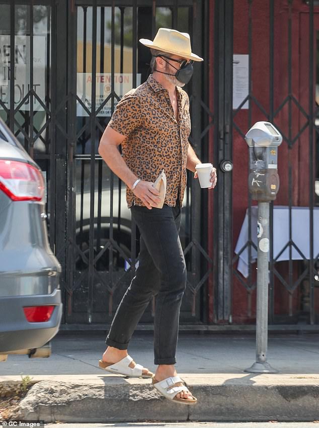 Chris-Pine-rocks-leopard-print-shirt-and-gold-medallion-in-Los-Feliz-3